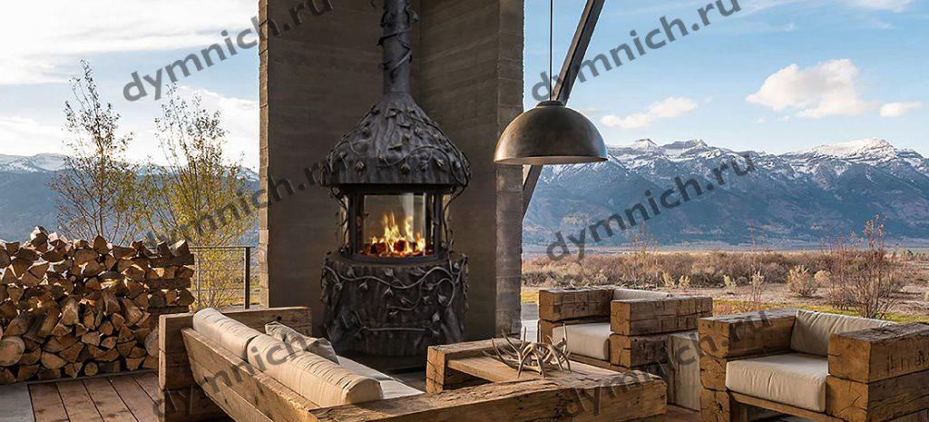 Островной камин на открытой терассе с жаростойкими стеклами